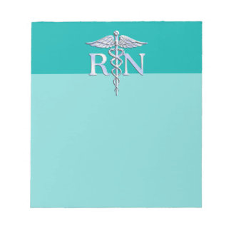 Registered Nurse RN Caduceus on Turquoise Notepad