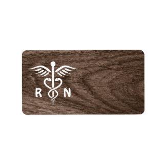 Registered nurse RN caduceus symbol on wood blank Label