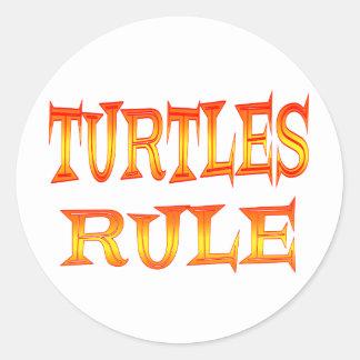 Regla de las tortugas pegatina redonda