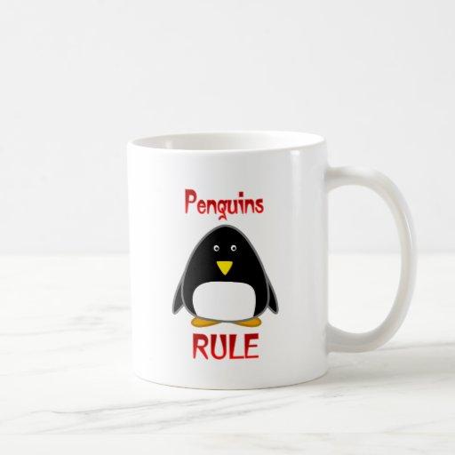 Regla de los pingüinos taza