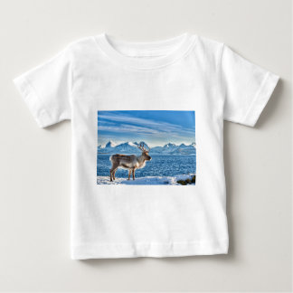 Reindeer in snow covered landscape at sea baby T-Shirt
