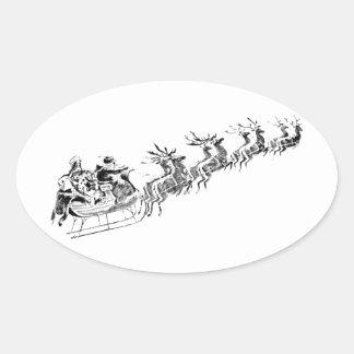 Reindeer Pulling Santa's Sleigh. Oval Sticker