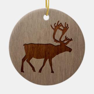 Reindeer silhouette engraved on wood design ceramic ornament