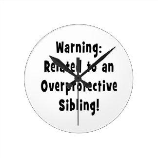 relacionado con sibling.png sobreprotector reloj de pared