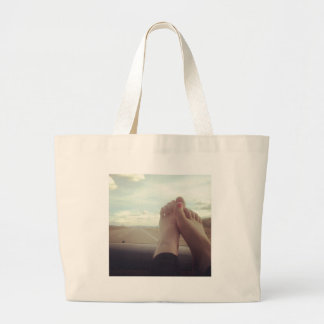 relax feet on the dashboard large tote bag