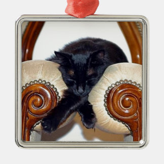 Relaxed Black Cat Sleeping Between Two Chairs Metal Ornament
