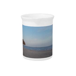 Relaxing Ocean Beach Witth Palm Tree Umbrellas Pitcher