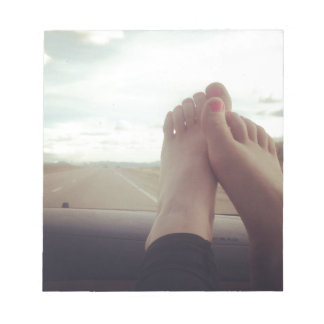relex feet on the dashboard notepad