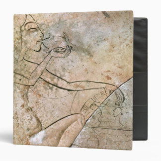 Relief depicing a princess eating a roasted binder
