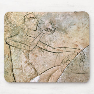 Relief depicing a princess eating a roasted mouse pad