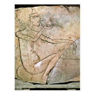 Relief depicing a princess eating a roasted postcard