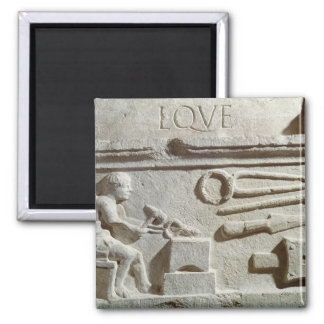 Relief depicting a blacksmith's shop and tools fridge magnet