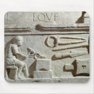 Relief depicting a blacksmith's shop and tools mousepad