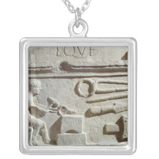 Relief depicting a blacksmith's shop and tools pendants