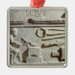 Relief depicting a blacksmith's shop and tools square metal christmas ornament