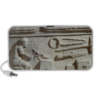 Relief depicting a blacksmith's shop and tools travelling speakers