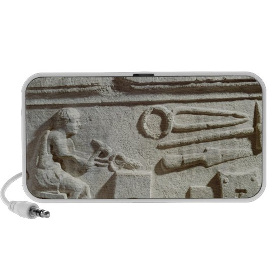 Relief depicting a blacksmith's shop and tools speaker