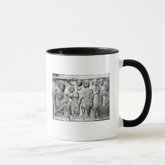 Relief depicting a boy reading to his teacher mug