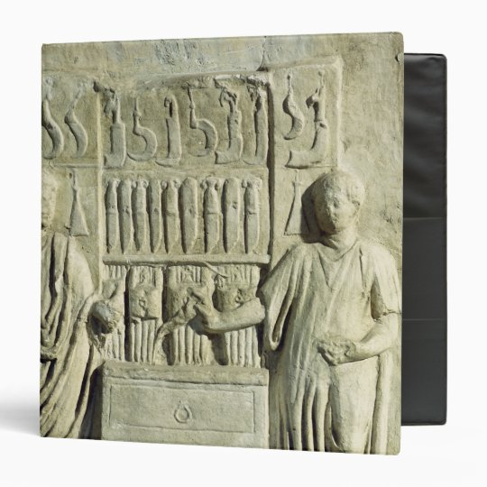 Relief depicting a cutlery shop 3 ring binder