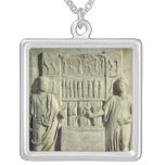 Relief depicting a cutlery shop silver plated necklace