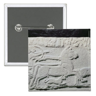 Relief depicting a deer hunt 2 inch square button
