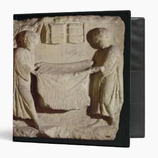 Relief depicting a draper in his shop 3 ring binder