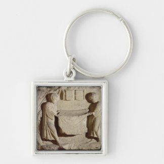Relief depicting a draper in his shop keychain