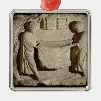 Relief depicting a draper in his shop metal ornament