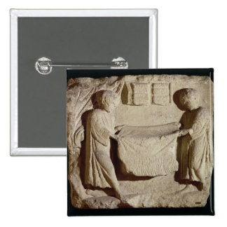 Relief depicting a draper in his shop pinback button