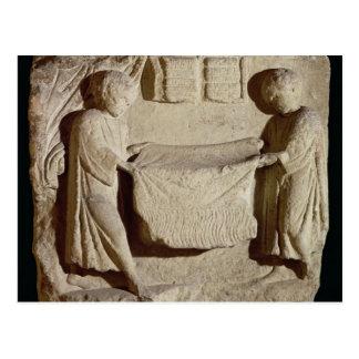 Relief depicting a draper in his shop postcard