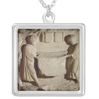 Relief depicting a draper in his shop silver plated necklace