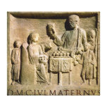 Relief depicting a family meal canvas print