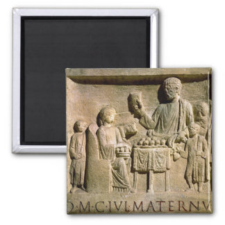 Relief depicting a family meal magnet
