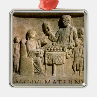 Relief depicting a family meal metal ornament