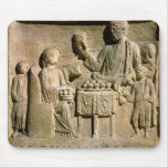 Relief depicting a family meal mouse pad