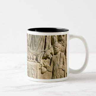 Relief depicting a family meal coffee mugs