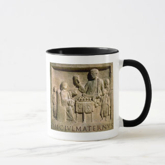 Relief depicting a family meal mug