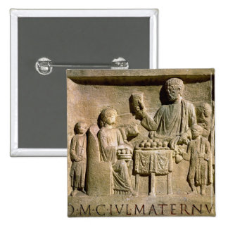 Relief depicting a family meal pinback button