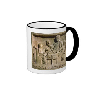 Relief depicting a family meal ringer mug