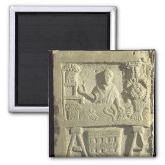 Relief depicting a flower and vegetable seller fridge magnet