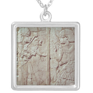 Relief depicting a guard holding silver plated necklace