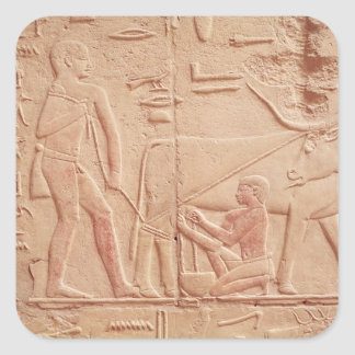 Relief depicting a man milking a cow square stickers