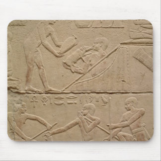 Relief depicting a man tending a new-born piglet mouse pad