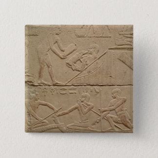 Relief depicting a man tending a new-born piglet pinback button