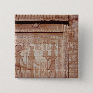 Relief depicting a pharaoh pinback button