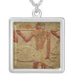 Relief depicting a porter square pendant necklace