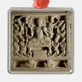Relief depicting a Seated Buddha preaching Metal Ornament