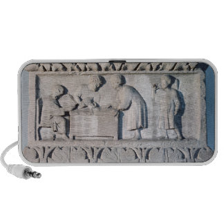 Relief depicting a tax collecting scene laptop speaker