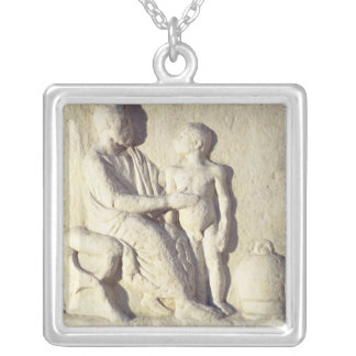 Relief depicting a visit to the doctor silver plated necklace