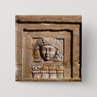 Relief depicting a woman at a window button